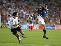 Landon Donovan brings the ball down in front of Thomas Linke. The USA lost to Germany 1-0 in the Quarterfinals of the FIFA World Cup 2002 in South Korea on June 21, 2002.