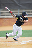 Joey Rodriguez (8) of the Wake Forest Demon Deacons is hit by the baseball as he tried to lay down a bunt against the Clemson Tigers at David F. Couch Ballpark on March 12, 2016 in Winston-Salem, North Carolina.  The Tigers defeated the Demon Deacons 6-5.  (Brian Westerholt/Four Seam Images)