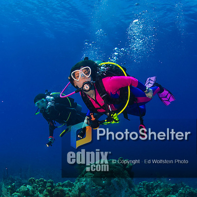 20 June 2016: SCUBA Divers Sally Herschorn and Josh Wolfstein explore the reef adjacent the Wreck of the Doc Poulson off the shores of 7-Mile Beach on the West side of Grand Cayman Island. Located in the British West Indies in the Caribbean, the Cayman Islands are renowned for excellent scuba diving, snorkeling, beaches and banking.  Mandatory Credit: Ed Wolfstein Photo *** RAW (NEF) Image File Available ***