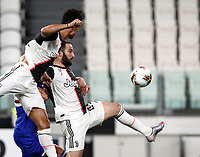 Calcio, Serie A: Juventus - Sampdoria, Turin, Allianz Stadium, July 26, 2020.<br /> Juventus'  Gonzalo Higuain (r) in action with his teammate Cristiano Ronaldo (l) during the Italian Serie A football match between Juventus and - Sampdoria at the Allianz stadium in Turin, July 26, 2020.<br /> UPDATE IMAGES PRESS/Isabella Bonotto