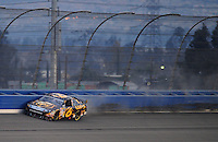 Feb 22, 2009; Fontana, CA, USA; NASCAR Sprint Cup Series driver David Ragan hits the wall during the Auto Club 500 at Auto Club Speedway. Mandatory Credit: Mark J. Rebilas-