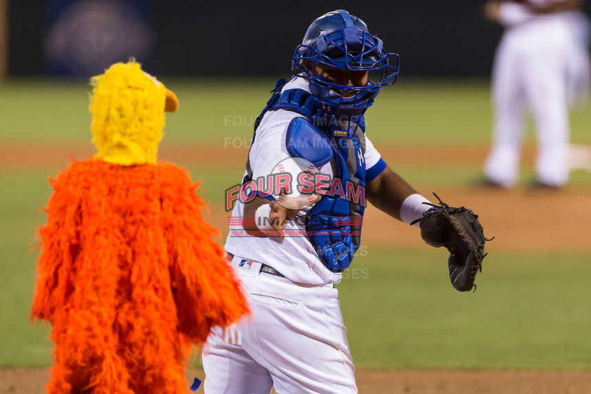 AFL West catcher Keibert Ruiz (17), of the Glendale Desert Dogs and Los Angeles Dodgers organization, tries to scare one of the San Diego Chicken's chiclets between innings of the Arizona Fall League Fall Stars game at Surprise Stadium on November 3, 2018 in Surprise, Arizona. The AFL West defeated the AFL East 7-6 . (Zachary Lucy/Four Seam Images)