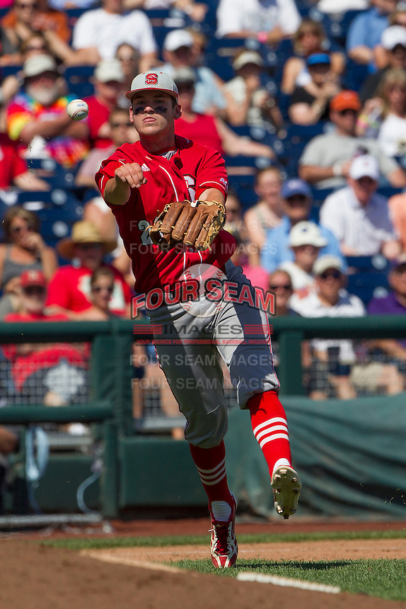 North Carolina State third baseman Grant Clyde (22) makes a throw to first base during Game 3 of the 2013 Men's College World Series between the North Carolina State Wolfpack and North Carolina Tar Heels at TD Ameritrade Park on June 16, 2013 in Omaha, Nebraska. The Wolfpack defeated the Tar Heels 8-1. (Andrew Woolley/Four Seam Images)
