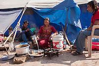A Nepali woman makes tea at a shelter home near to the Kathmandu Durbar Square, Kathmandu, Nepal.<br />  May 03, 2015