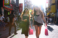 Pedestrians at the intersection in Shibuya District of Tokyo, where a lot of Japanese young generations hang out.  <br /> 16 Jul 2010