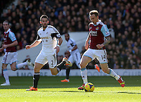 Pictured L-R: Jordi Amat of Swansea against Matt Taylor of West Ham. 01 February 2014<br />