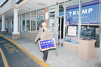 "Trump supporter Richard Lempitsky, of Cumberland, Rhode Island, carries signs out of the Rhode Island state campaign headquarters for Republican presidential candidate Donald Trump at the Airport Plaza strip mall in Warwick, Rhode Island, USA, on Sun., Apr. 24, 2016. The campaigns of Trump, Cruz, and Kasich, have all set up offices in the strip mall. Lempitsky said, ""I've been a Republican all my life. Since Goldwater."""