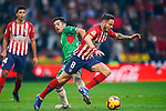 Saul Niguez Esclapez of Atletico de Madrid (R) competes for the ball with Jonathan Rodriguez Menendez, Jony, of Deportivo Alaves during the La Liga 2018-19 match between Atletico de Madrid and Deportivo Alaves at Wanda Metropolitano on December 08 2018 in Madrid, Spain. Photo by Diego Souto / Power Sport Images