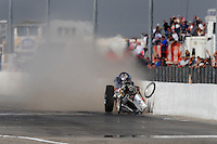 Mar. 6, 2009; Bakersfield, CA, USA; Nostalgia top fuel dragster driver Dan Horan hits the wall after crashing into Mike Chrisman (not pictured) during qualifying for the 51th annual March Meet at the Auto Club Famoso Raceway. Both drivers were ok. Mandatory Credit: Mark J. Rebilas-