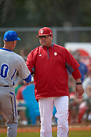 Indiana Hoosiers head coach Chris Lemonis shakes hands with Rob Sheppard (40) after a game against the Seton Hall Pirates on March 5, 2016 at North Charlotte Regional Park in Port Charlotte, Florida.  Seton Hall defeated Indiana 6-4.  (Mike Janes/Four Seam Images)