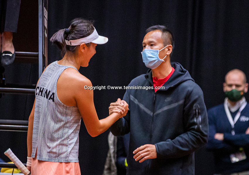 Den Bosch, The Netherlands, April 16, 2021,    Maaspoort, Billy Jean King Cup  Netherlands -  China , seccond Match:  Xiyu Wang (CHN) is congratulated by her captain after defeating Arantxa Rus (NED) and making the  score equal 1-1<br /> Photo: Tennisimages/Henk Koster