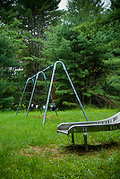 Swing set and slide in playground