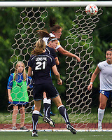 Boston Breakers defender Cat Whitehill (4) and New York Fury midfielder Sinead Farrelly (17) compete for a head ball at goal.  The Boston Breakers beat the New York Fury 2-0 at Dilboy Stadium.