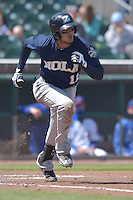 Miguel Rojas (11) of the New Orleans Zephyrs runs toward first base against the Iowa Cubs at Principal Park on April 23, 2015 in Des Moines, Iowa.  The Zephyrs won 9-2.  (Dennis Hubbard/Four Seam Images)