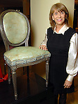"""Designer Karen Moore with her chair titled """"Fabulously Finishes"""" at the Les Provinciales Design for a Cause event at Roche Bobois Thursday Dec. 10,2009.(Dave Rossman/For the Chronicle)"""