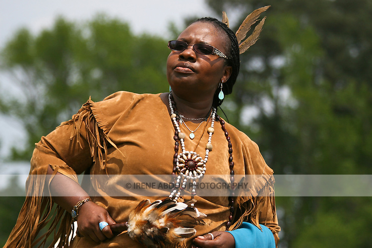 A Native American woman in full traditional regalia parades in the dance circle at the 8th Annual Red Wing PowWow in Virginia Beach, Virginia.