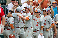 The Texas Longhorns bench celebrates after Mark Payton (2) hit a first inning home run during the NCAA baseball game against the Houston Cougars on June 6, 2014 at UFCU Disch–Falk Field in Austin, Texas. The Longhorns defeated the Cougars 4-2 in Game 1 of the NCAA Super Regional. (Andrew Woolley/Four Seam Images)