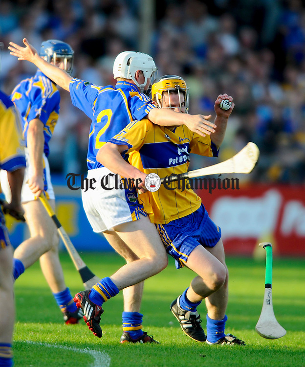 Tippearry's Brendan Maher gets to grips with Clare's John Conlon during the Munster U-21 final at Cusack Park. Photograph by John Kelly.