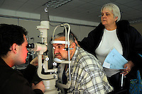 Barbara and Jessie McBee, both 60, take an eye test. Over the weekend at Soft Shell, Knott County, in the Appalachian mountains of eastern Kentucky, the congressional district with the nation's lowest life expectancy, RAM volunteers saw 822 needy people. 95 percent of people seen were provided with dental or optical care. RAM was founded in 1985 to provide free health, dental and eye care in the developing world. However, RAM now provides 60 percent of its services in the US, providing for the estimated 47 million Americans without health insurance..