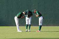 Greenville Drive outfielders Wil Dalton (26), Tyler Esplin (25), and Cole Brannen (5) take a bow after an 8-3 win over the Hickory Crawdads on Sunday, August 29, 2021, at Fluor Field at the West End in Greenville, South Carolina. (Tom Priddy/Four Seam Images)