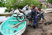 Loading the Motorcycle to a little boat in Chacahua Island, Oaxaca, Mexico. May 26, 2006.Born in Argentina, photographer Ivan Pisarenko in 2005  decided to ride his motorcycle across the American continent. While traveling Ivan is gathering an exceptional photographic document on the more diverse corners of the region. Archivolatino will publish several stories by this talented young photographer...
