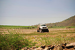 Truck spraying Round up on farm field