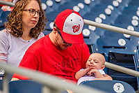 22 September 2018: A Washington Nationals Fan brings his newborn baby to a ballgame against the New York Mets at Nationals Park in Washington, DC. The Nationals shut out the Mets 6-0 in the 3rd game of their 4-game series. Mandatory Credit: Ed Wolfstein Photo *** RAW (NEF) Image File Available ***