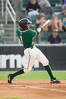 Carlos Paulino #1 of the Greensboro Grasshoppers follows through on his swing against the Kannapolis Intimidators at Fieldcrest Cannon Stadium August 3, 2010, in Kannapolis, North Carolina.  Photo by Brian Westerholt / Four Seam Images