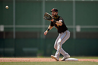Pittsburgh Pirates first baseman Brendt Citta (13) stretches for a throw during a Minor League Spring Training game against the Baltimore Orioles on April 21, 2021 at Pirate City in Bradenton, Florida.  (Mike Janes/Four Seam Images)