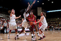 STANFORD, CA - November 14, 2010: Kayla Pedersen (14), Chiney Ogwumike (13) and Jeanette Pohlen (23) during a basketball game against Rutgers at Stanford University in Stanford, California. Stanford won 63-50.