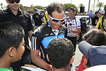 Sky Procycling riders Davide Appollonio (ITA) signs autographs for local school children before the start of the 3rd Stage of the 2012 Tour of Qatar running 146.5km from Dukhan Souq, Dukhan to Al Gharafa, Qatar. 7th February 2012.<br /> (Photo Eoin Clarke/Newsfile)