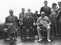 President Roosevelt; Canadian Prime Minister, Mackenzie King and British Prime Minister, Winston Churchill. On the wall seated is Anthony Eden, Secretary of Foreign Affairs of Britain; Mr. Brendan Bracken, Britains Minister of Information and Harry Hopkins, Advisor to the President of the United States. 08/24/43.