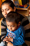 Toddler program shy two year old boy with mother