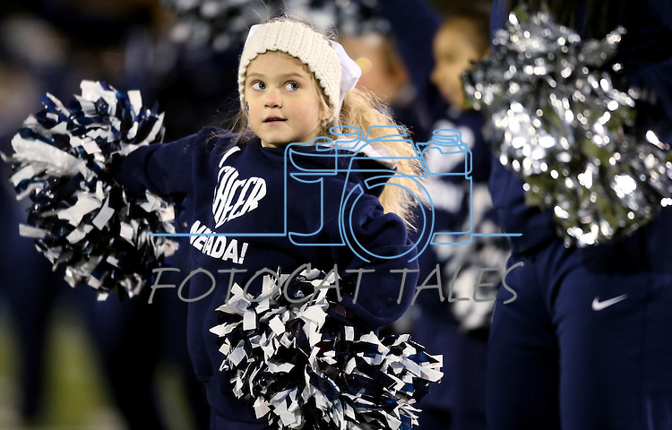 Jenna Reed, 5, cheers with Nevada Cheerleader's Perform with the Pack youth program before the start of an NCAA college football game between Nevada and San Jose State, in Reno, Nev., on Saturday, Nov. 16, 2013. (AP Photo/Cathleen Allison)