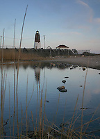 Point Judith Lighthouse is reflected in one of the nearby coastal ponds