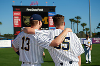 Michigan Wolverines Dominic Clementi (13) and Brock Keener (35) before a game against Army West Point on February 18, 2018 at Tradition Field in St. Lucie, Florida.  Michigan defeated Army 7-3.  (Mike Janes/Four Seam Images)