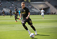 LOS ANGELES, CA - APRIL 17: Corey Baird #13 of LAFC moves to the ball during a game between Austin FC and Los Angeles FC at Banc of California Stadium on April 17, 2021 in Los Angeles, California.