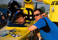 Aug. 30, 2013; Clermont, IN, USA: Jeg Coughlin Jr (right) gives some instruction to his nephew NHRA super comp driver Troy Coughlin Jr during qualifying for the US Nationals at Lucas Oil Raceway. Mandatory Credit: Mark J. Rebilas-