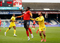 3rd October 2020; Kenilworth Road, Luton, Bedfordshire, England; English Football League Championship Football, Luton Town versus Wycombe Wanderers; Pelly Ruddock of Luton Town chests the ball with Jordan Clark of Luton Town marking