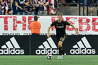 FOXBOROUGH, MA - AUGUST 3: Walker Zimmerman #25 of Los Angeles FC brings the ball forward during a game between Los Angeles FC and New England Revolution at Gillette Stadium on August 3, 2019 in Foxborough, Massachusetts.
