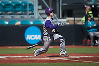 Daniel Walsh (19) of the Western Carolina Catamounts follows through on his swing against the Kennesaw State Owls at Springs Brooks Stadium on February 22, 2020 in Conway, South Carolina. The Owls defeated the Catamounts 12-0.  (Brian Westerholt/Four Seam Images)