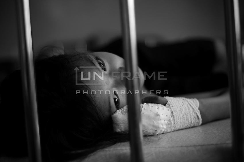 Washed out eyes of a traumatised girl. Health care workers in Cambodia are often not sufficiently qualified in the issues of pediatric health, families often lack proper health care knowledge.