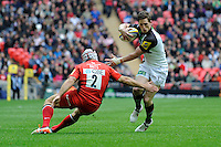 Tom Williams of Harlequins sidesteps Schalk Brits of Saracens during the Aviva Premiership match between Saracens and Harlequins at Wembley Stadium on Saturday 31st March 2012 (Photo by Rob Munro)