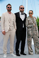 """CANNES, FRANCE - JULY 13:  Hilmir Snaer Gudnason, Director Valdimar Johannsson, Noomi Rapace at the """"Lamb"""" photocall during the 74th annual Cannes Film Festival on July 13, 2021 in Cannes, France. <br /> CAP/GOL<br /> ©GOL/Capital Pictures"""