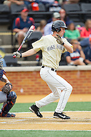 Evan Stephens (5) of the Wake Forest Demon Deacons follows through on his swing against the Virginia Cavaliers at Wake Forest Baseball Park on May 17, 2014 in Winston-Salem, North Carolina.  The Demon Deacons defeated the Cavaliers 4-3.  (Brian Westerholt/Four Seam Images)