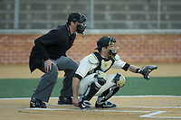 Wake Forest Demon Deacons catcher Logan Harvey (15) sets a target as home plate umpire Drew Maher looks on during the game against the Richmond Spiders at David F. Couch Ballpark on March 6, 2016 in Winston-Salem, North Carolina.  The Demon Deacons defeated the Spiders 17-4.  (Brian Westerholt/Four Seam Images)