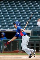 Jose Gonzalez #6 of the AZL Rangers bats against the AZL Royals at Surprise Stadium on July 15, 2013 in Surprise, Arizona. AZL Rangers defeated the AZL Royals, 3-2. (Larry Goren/Four Seam Images)