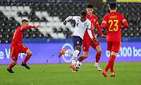 SWANSEA, WALES - NOVEMBER 12: Yunus Musah #18 of the United States battles for the ball during a game between Wales and USMNT at Liberty Stadium on November 12, 2020 in Swansea, Wales.