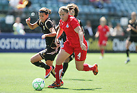 Cat Whitehill (4) dribbles the ball against Christine Sinclair (left). FC Gold Pride defeated Washington Freedom 3-2 at Buck Shaw Stadium in Santa Clara, California on August 1, 2009.