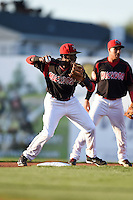Batavia Muckdogs shortstop Javier Lopez (22) attempts to turn a double play as Rony Cabrera (40) backs up the play during a game against the Auburn Doubledays on August 27, 2014 at Dwyer Stadium in Batavia, New York.  Auburn defeated Batavia 6-4.  (Mike Janes/Four Seam Images)